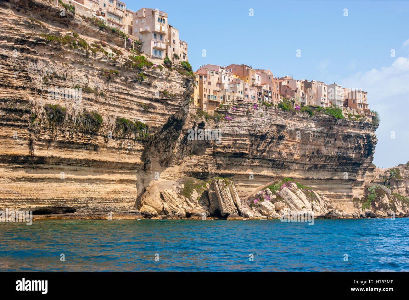 the medieval houses of the city of Bonifacio located on the edge of the cliff, Corsica - Stock Image