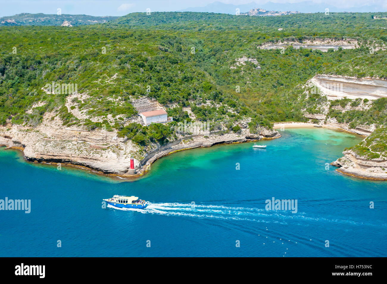 the haven of Bonifacio with tourist boat, Corsica - Stock Image