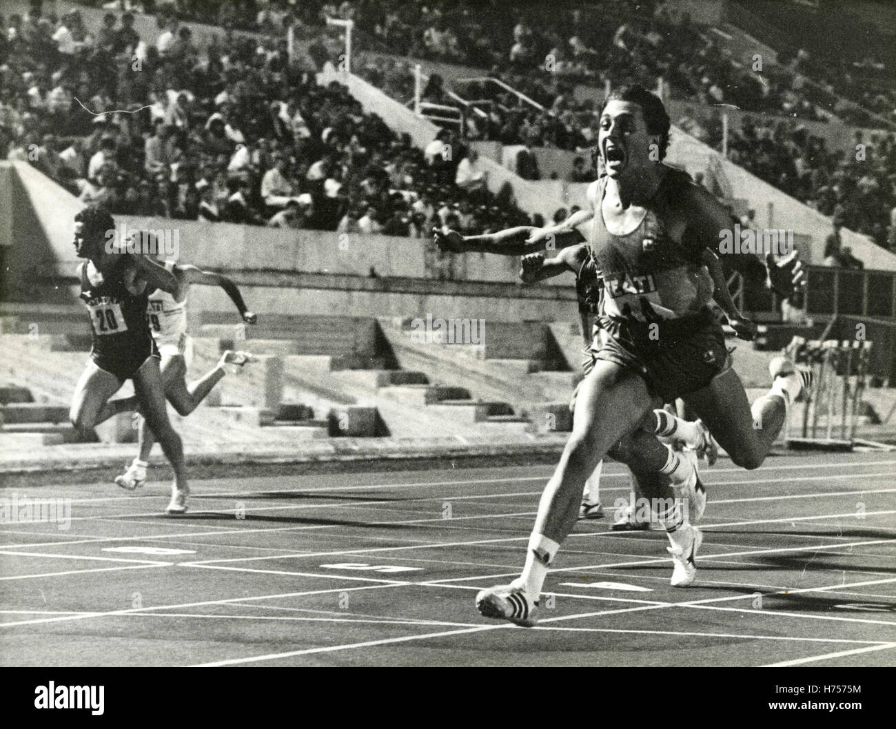 Athlete Stefano Tilli crosses the finish line of the 100 meters at the Italian Championships 1984 - Stock Image