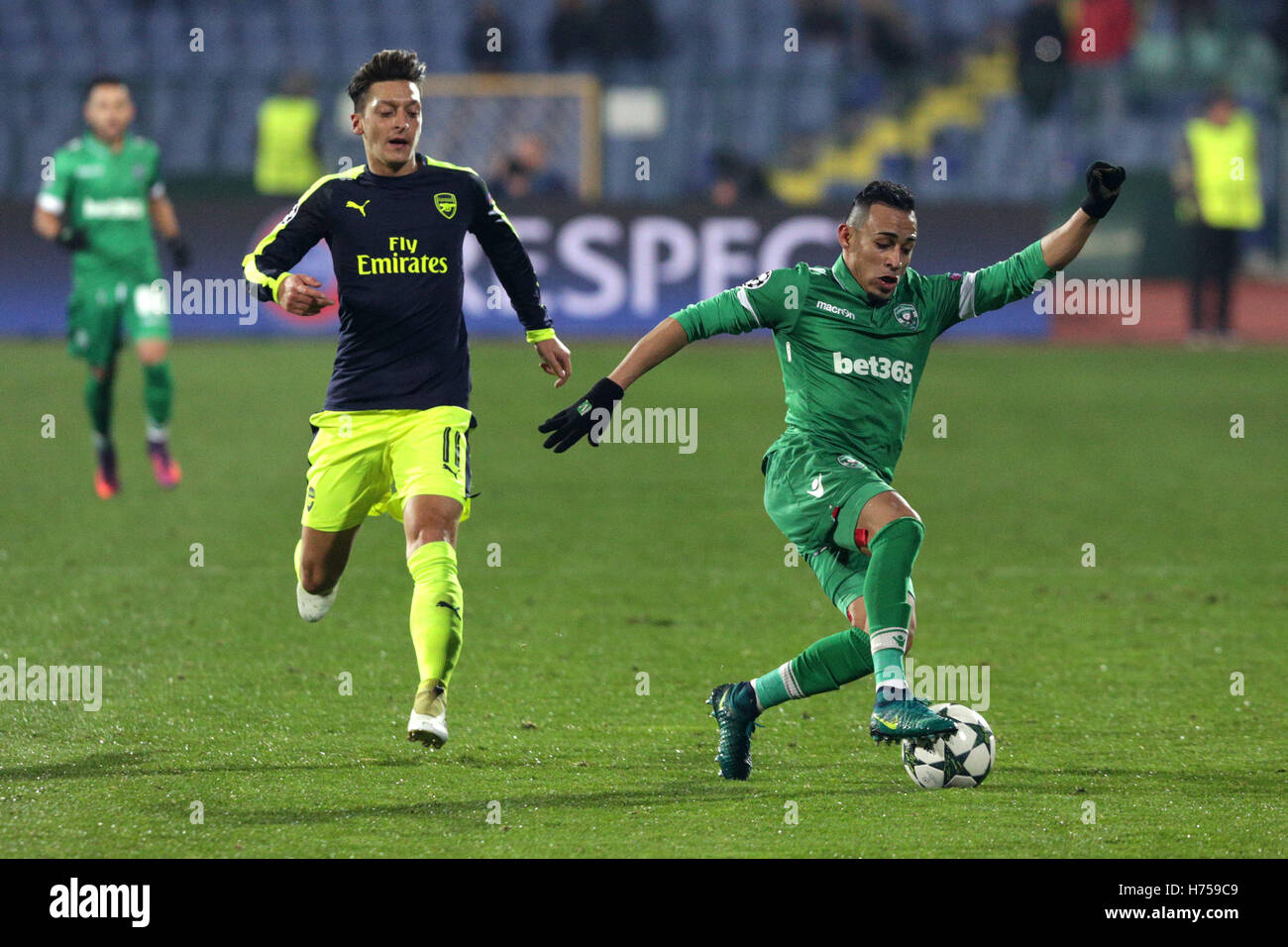 Sofia, Bulgaria - November 1, 2016: Arsenal's Mesut Ozil challenges Palomino Natanael during UEFA Champions League - Stock Image