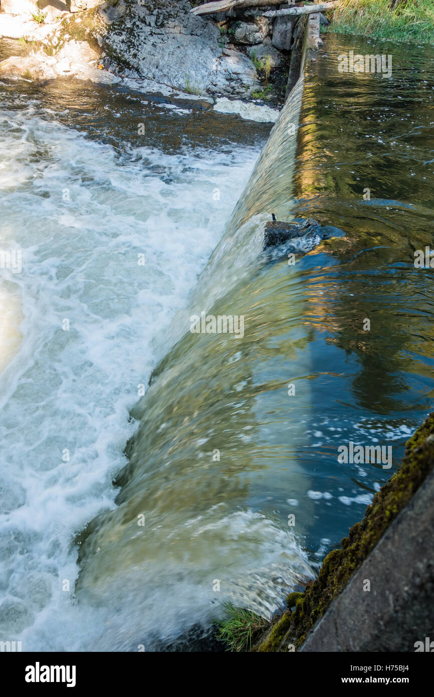 Flowing water at Tumwater Falls creates a shiny curtain. - Stock Image