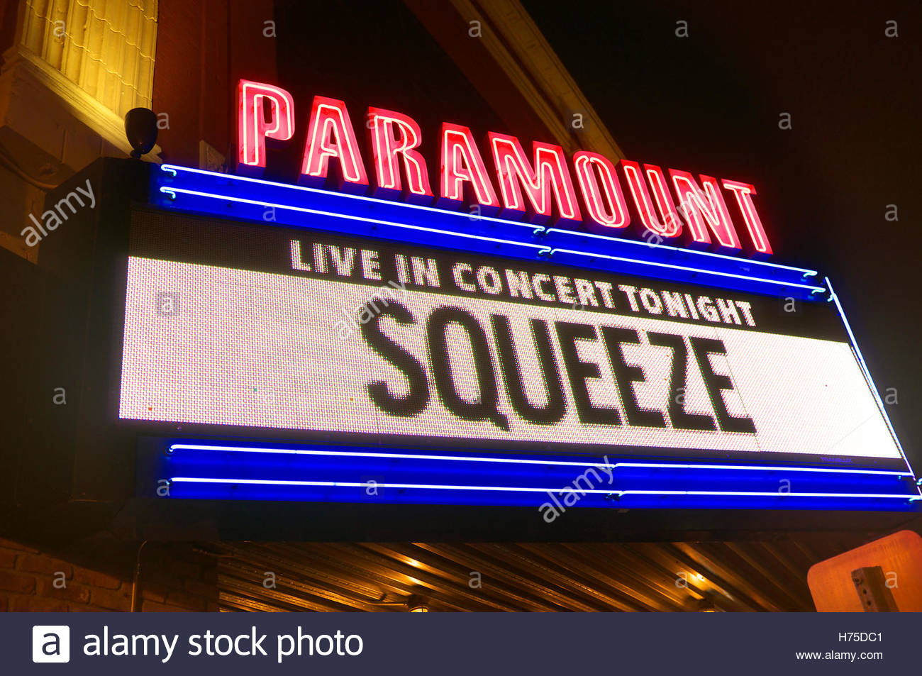 Marquee sign lit up, highlighting Squeeze concert, at the Paramount, in Huntington, Suffolk County, New York State, - Stock Image