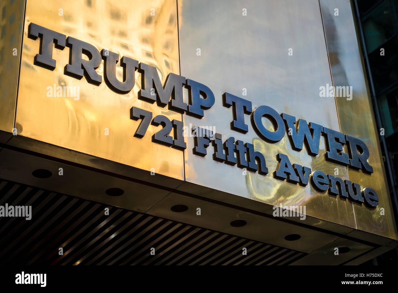 NEW YORK CITY - SEPTEMBER 3, 2016: Polished brass sign for Trump Tower shines on Fifth Avenue in Midtown Manhattan. - Stock Image