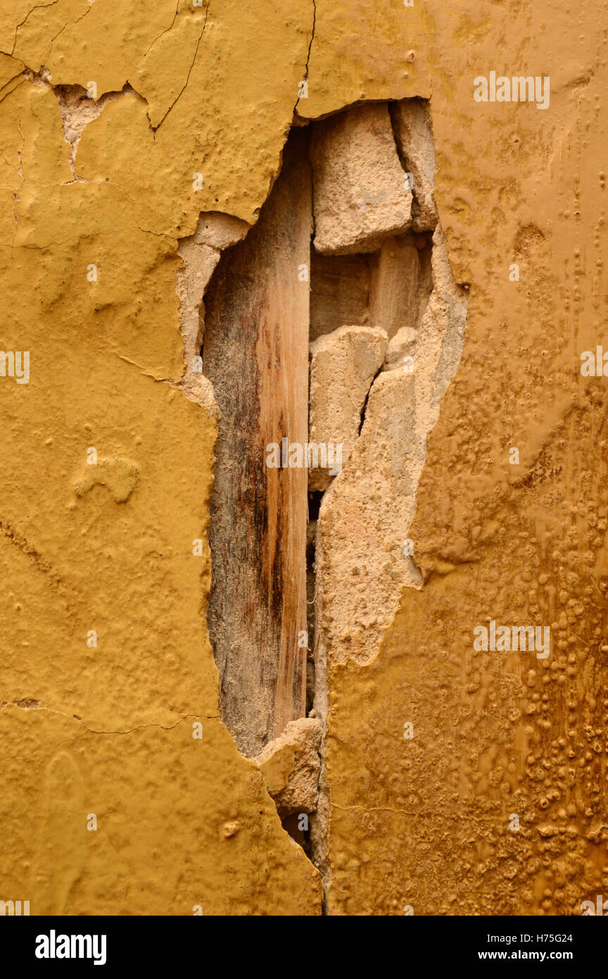 Breakaway plaster on the inside wall of the old house - Stock Image