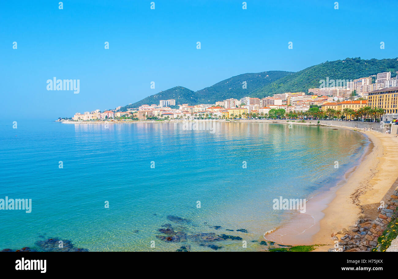 The central beach with the row of hotels, restaurants and living houses along the coast, Ajaccio, Corsica, France. - Stock Image