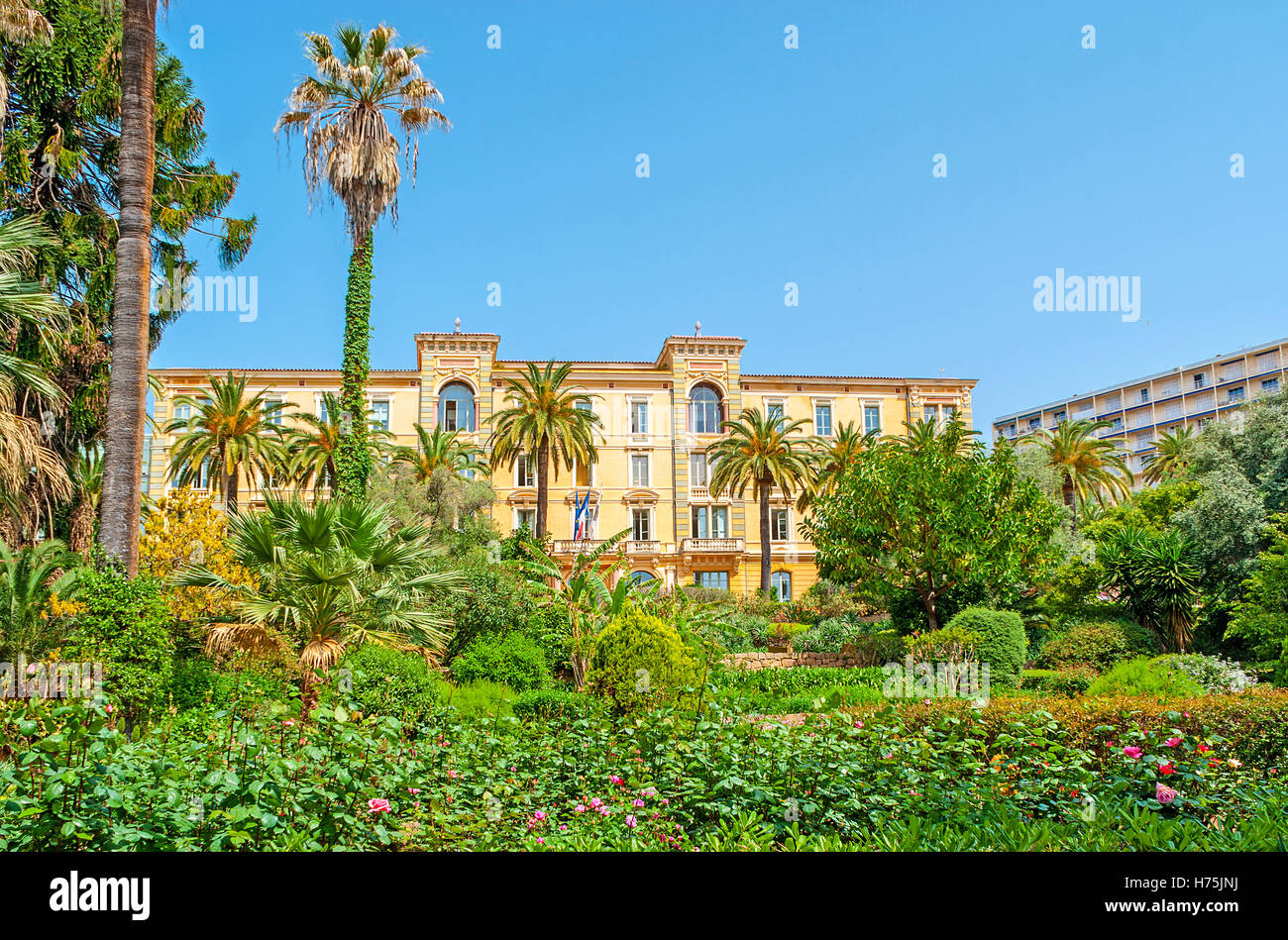 The lush garden hides the scenic mansion of  Corsican Assembly, that has it seat in Grand Hotel d'Ajaccio et - Stock Image