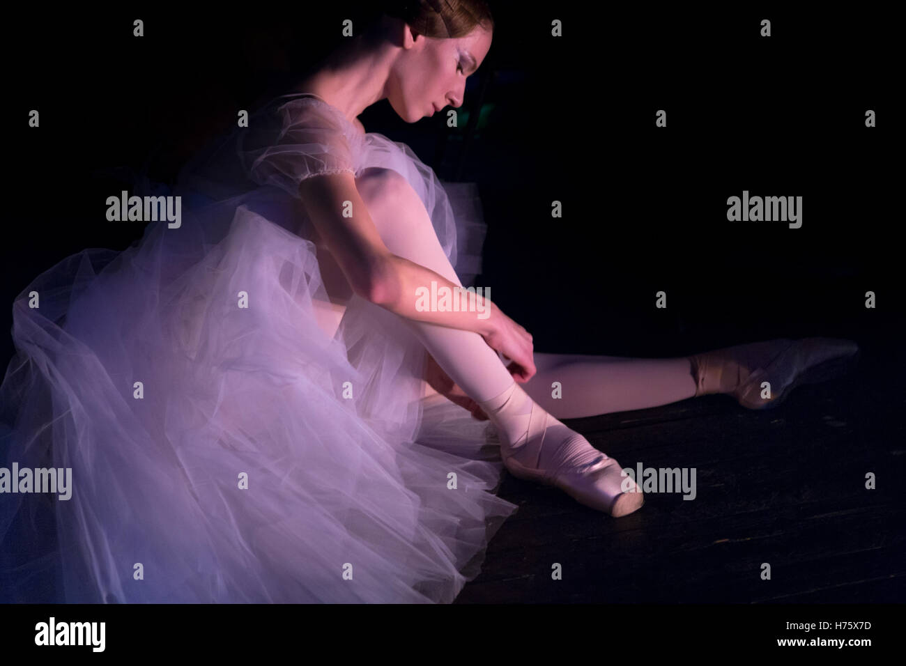 A ballerina is preparing to go on the stage before performance - Stock Image