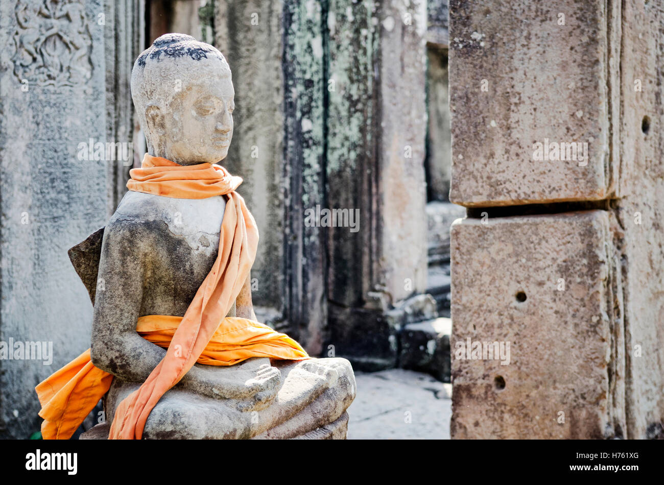 cambodian ancient buddha statue in famous landmark angkor wat temple siem reap cambodia - Stock Image