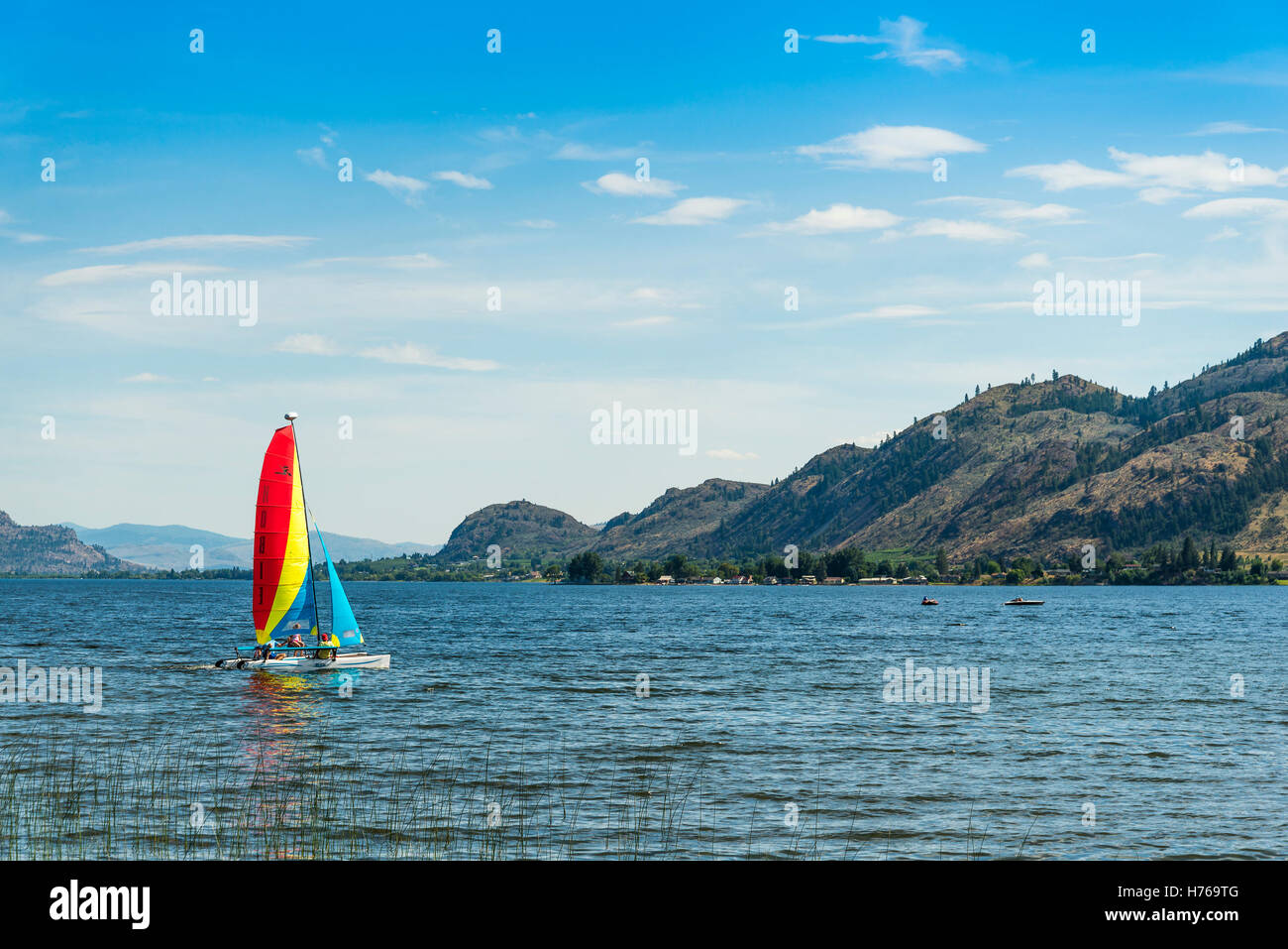 Catamaran sailboat on Osoyoos Lake, Osoyoos, British Columbia, Canada - Stock Image