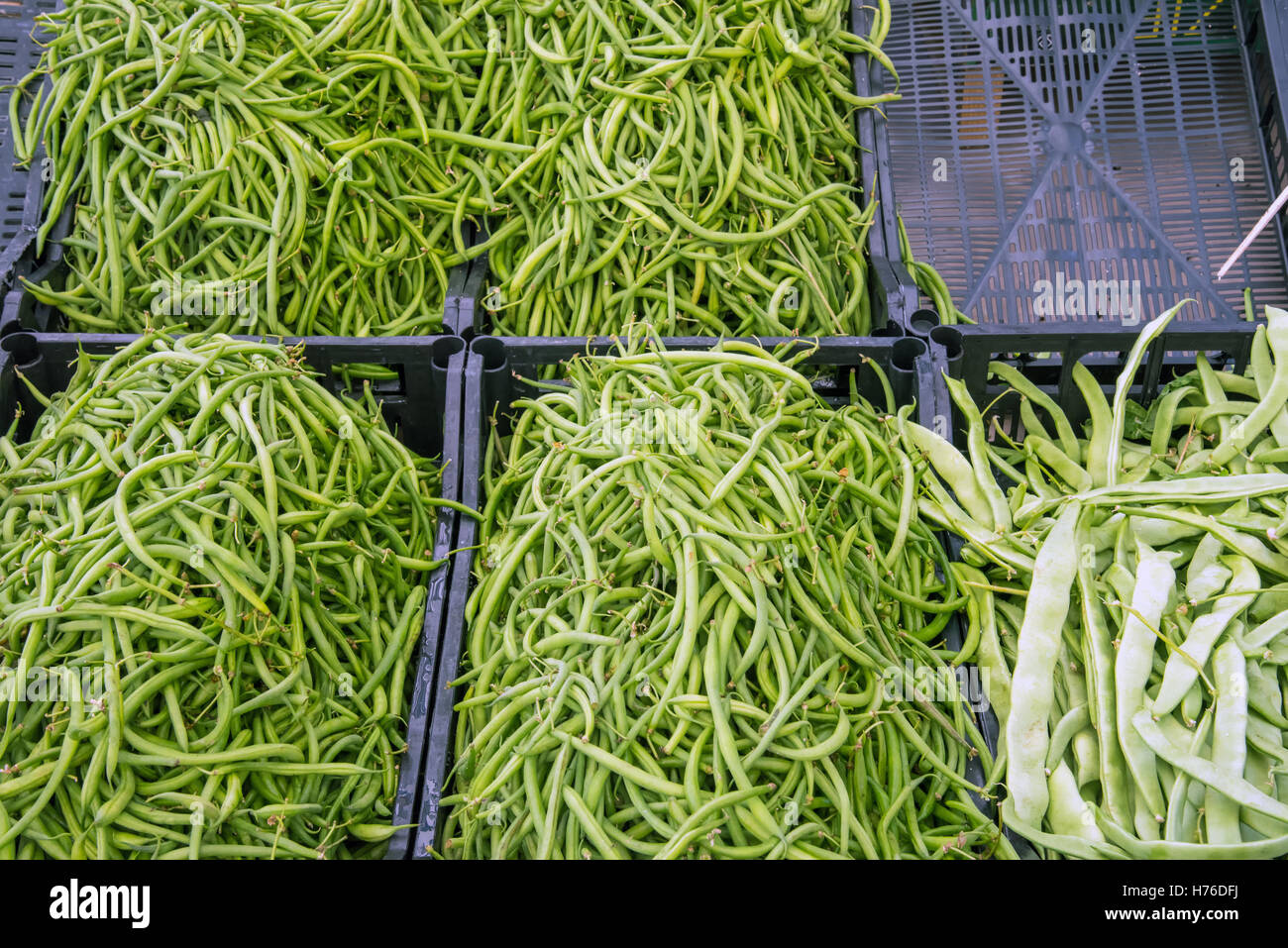Fresh green peas for sale at a market - Stock Image