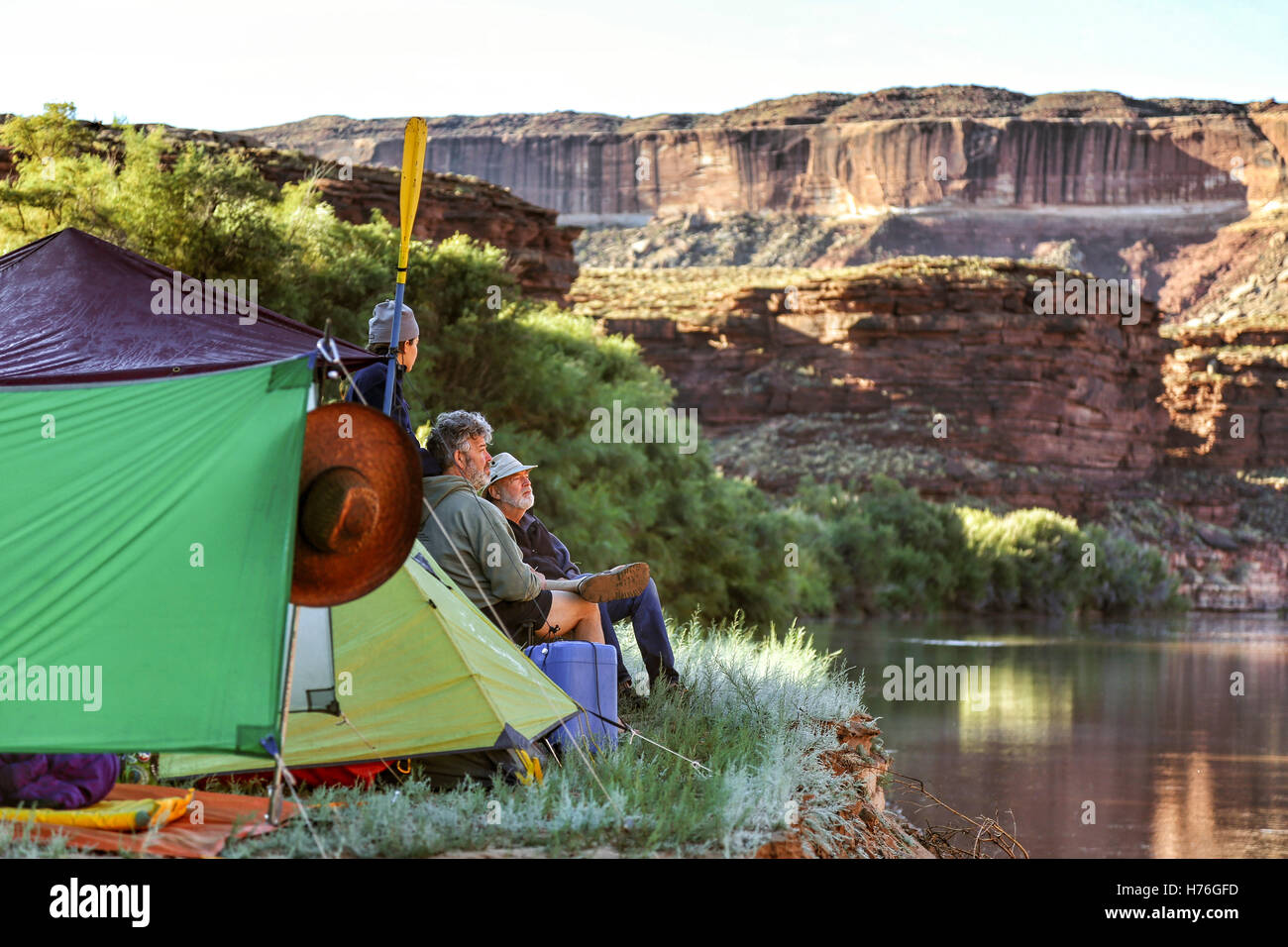 A multi-generational family of boaters looks out from their campsite at the Green River in Canyonlands National - Stock Image