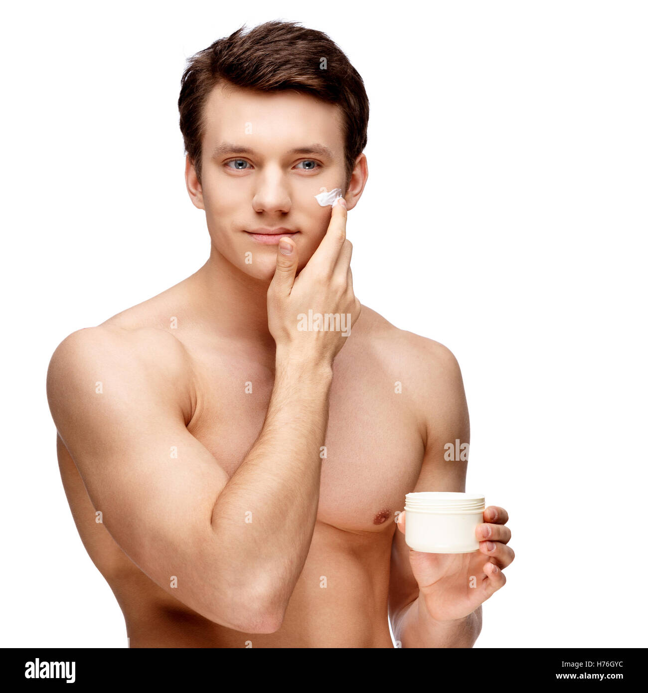 Handsome young man sniffing his armpit - Stock Image