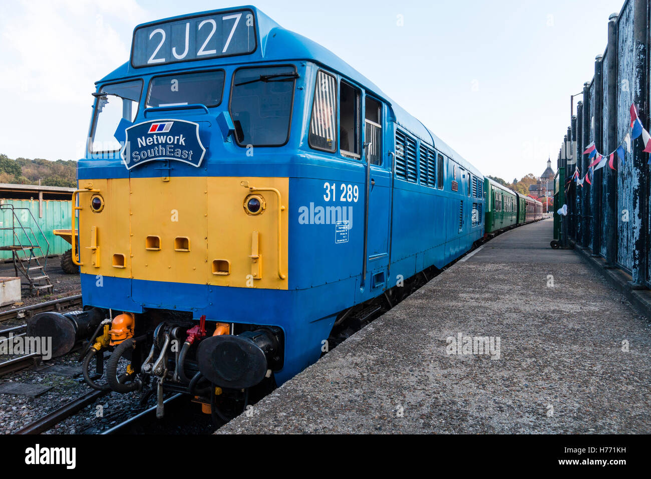 England, Spa Valley railway. British Rail Network South East class 31 type locomotive, blue and yellow livery, with - Stock Image