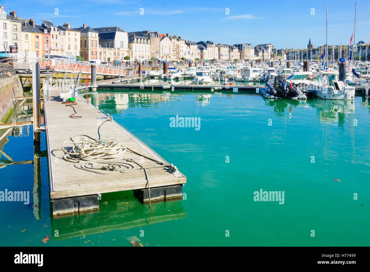 DIEPPE, FRANCE - SEPTEMBER 16, 2012: View of the port, with various boats, local businesses, locals and visitors, - Stock Image