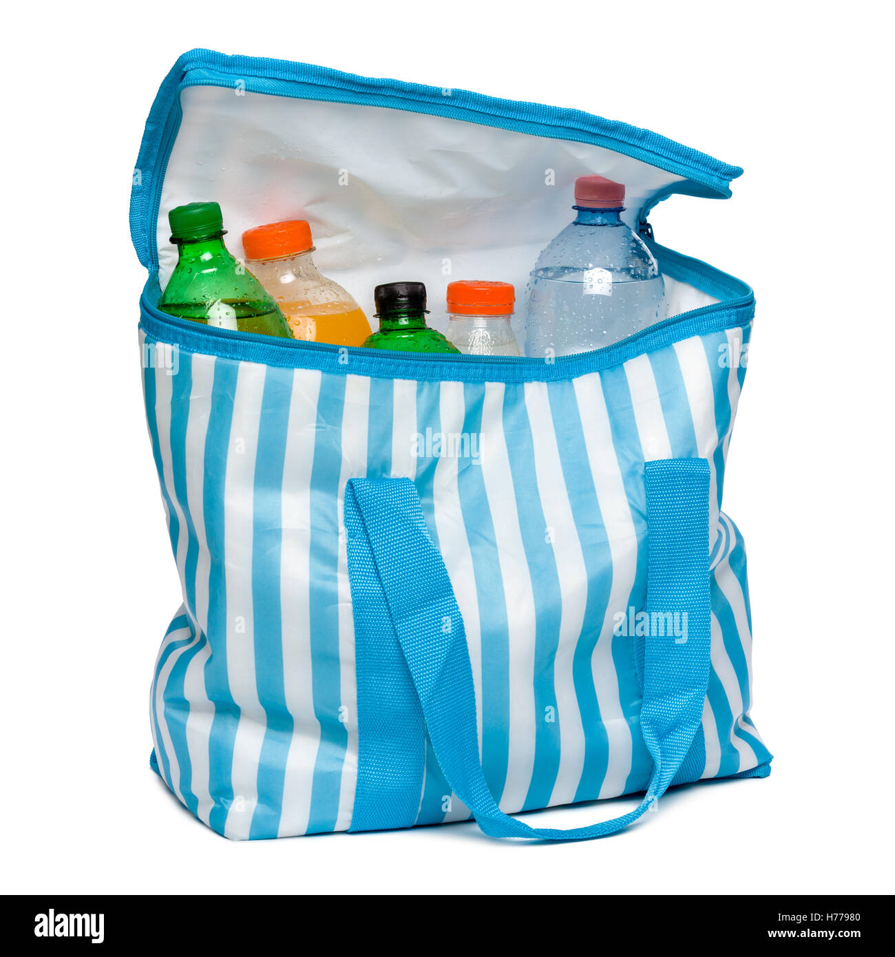 Open standing blue striped cooler bag with full of cool refreshing drinks - Stock Image