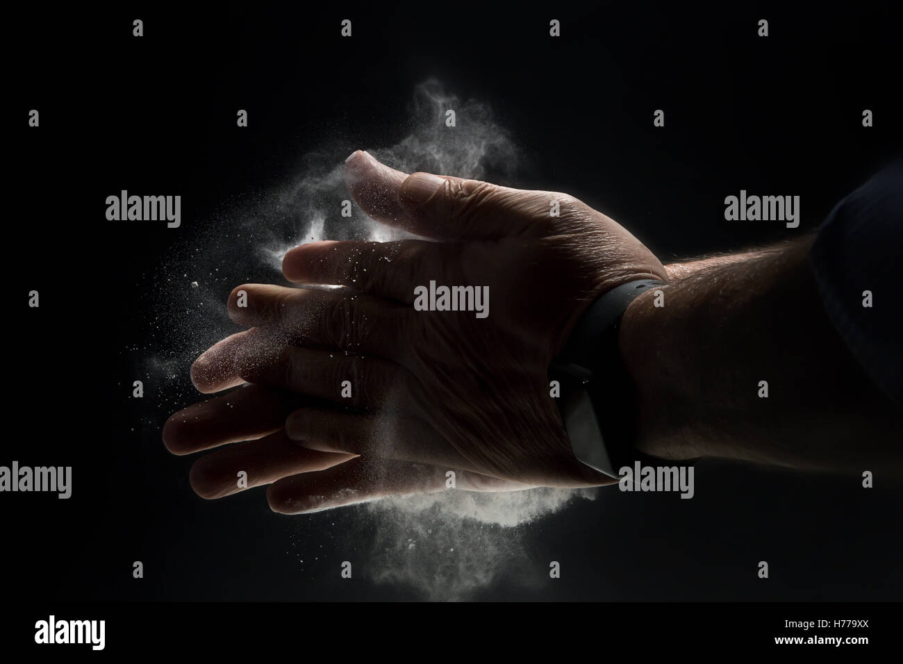 Close-up of hands  with  talcum powder - Stock Image