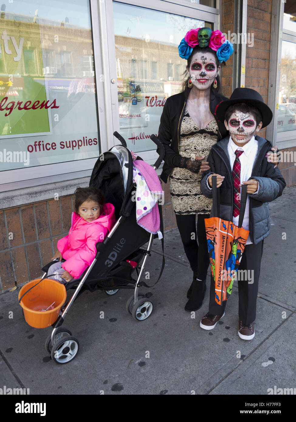 mexican family dressed in day of the dead costumes celebrate stock