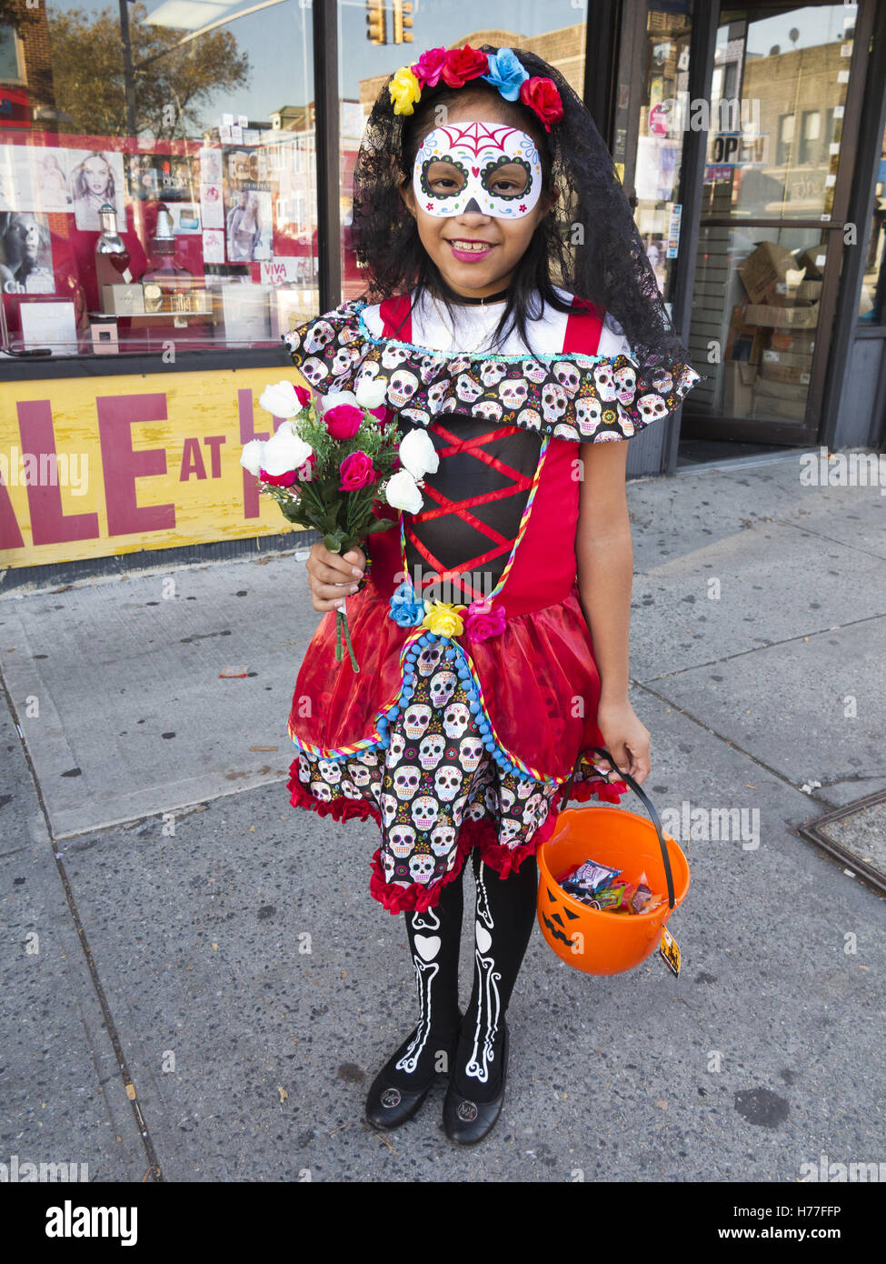 mexican girl in day of the dead costume celebrates halloween in the