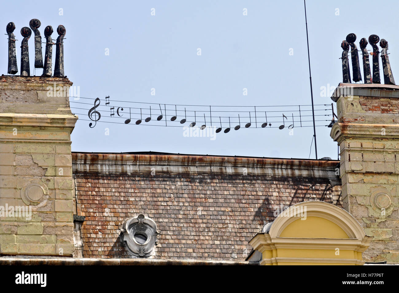 Rooftop with music pentagram decoration on top. - Stock Image