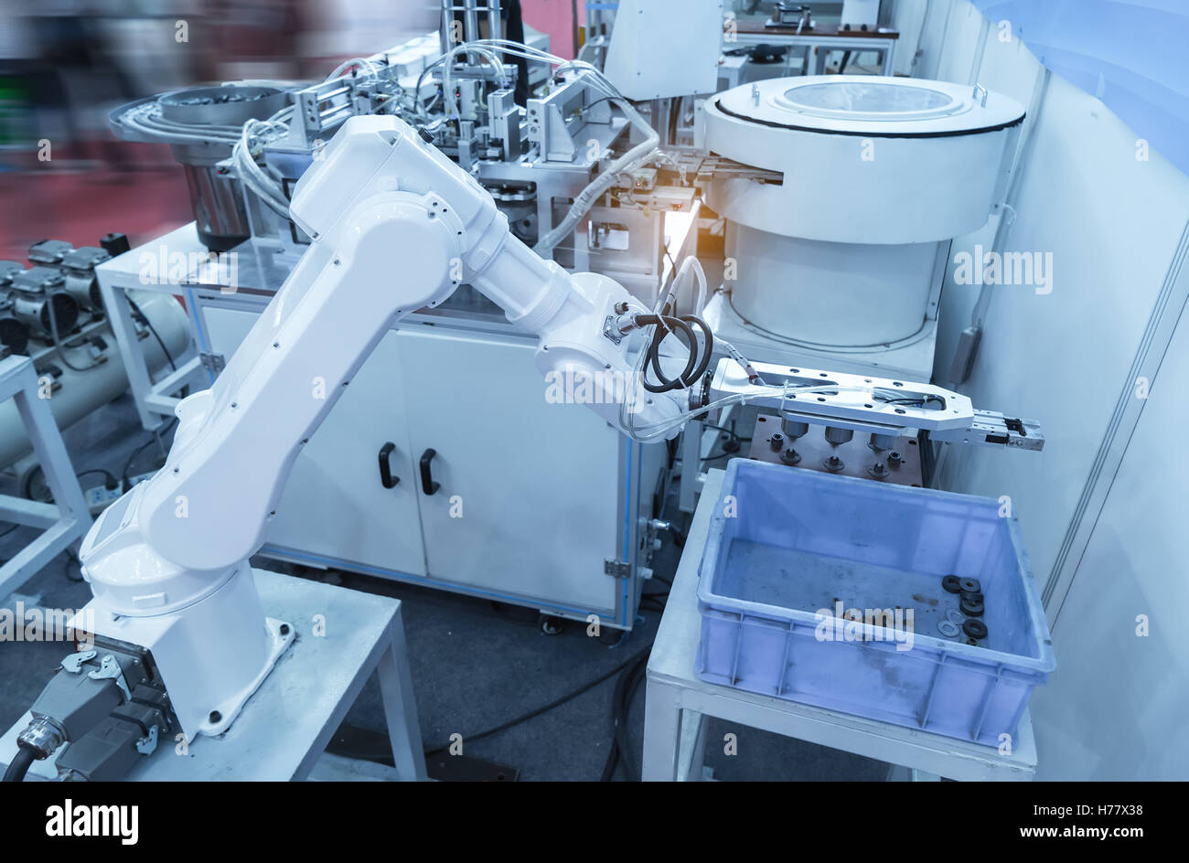 Robotic arm at production line in factory - Stock Image