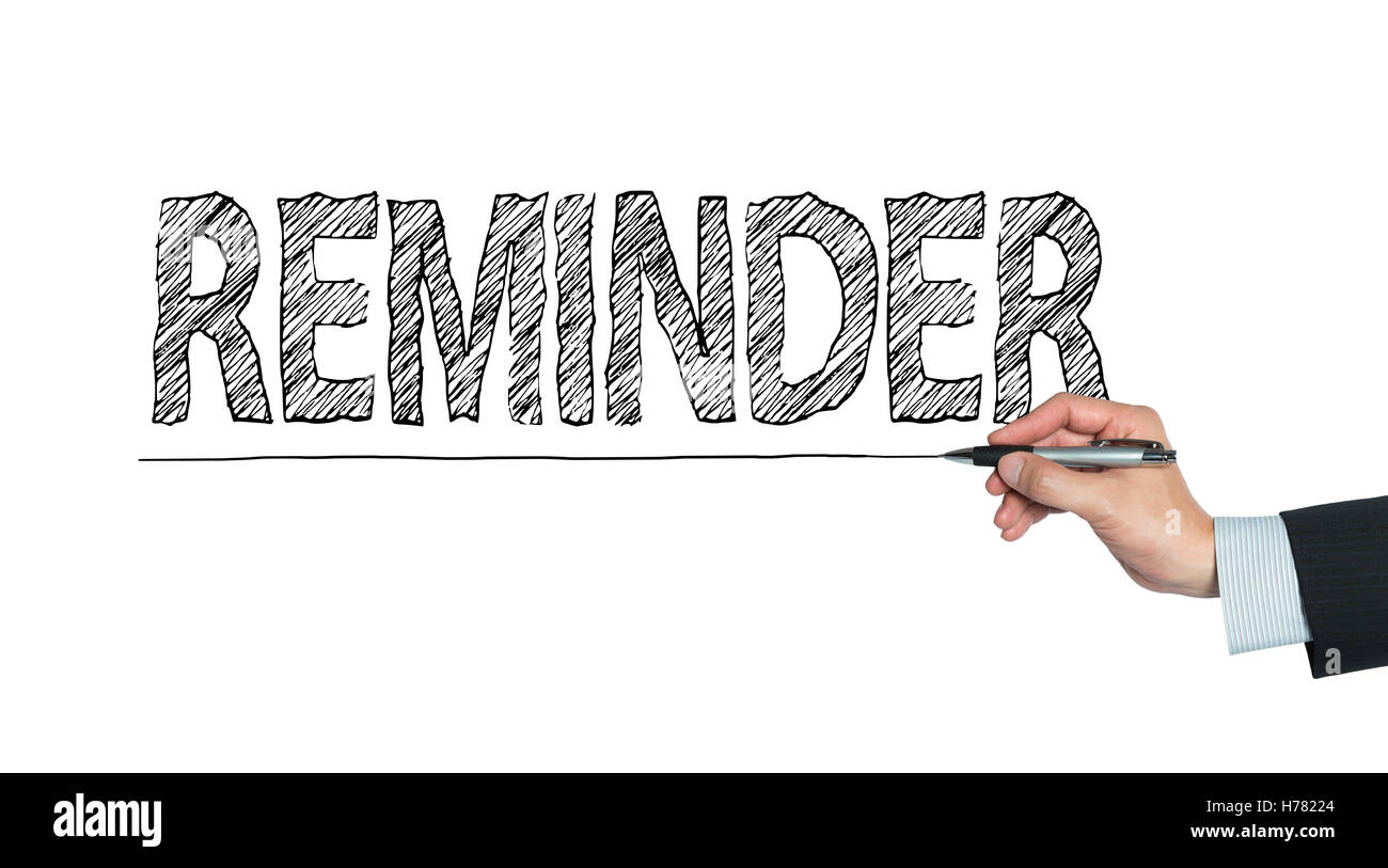reminder written by hand, hand writing on transparent board, photo - Stock Image