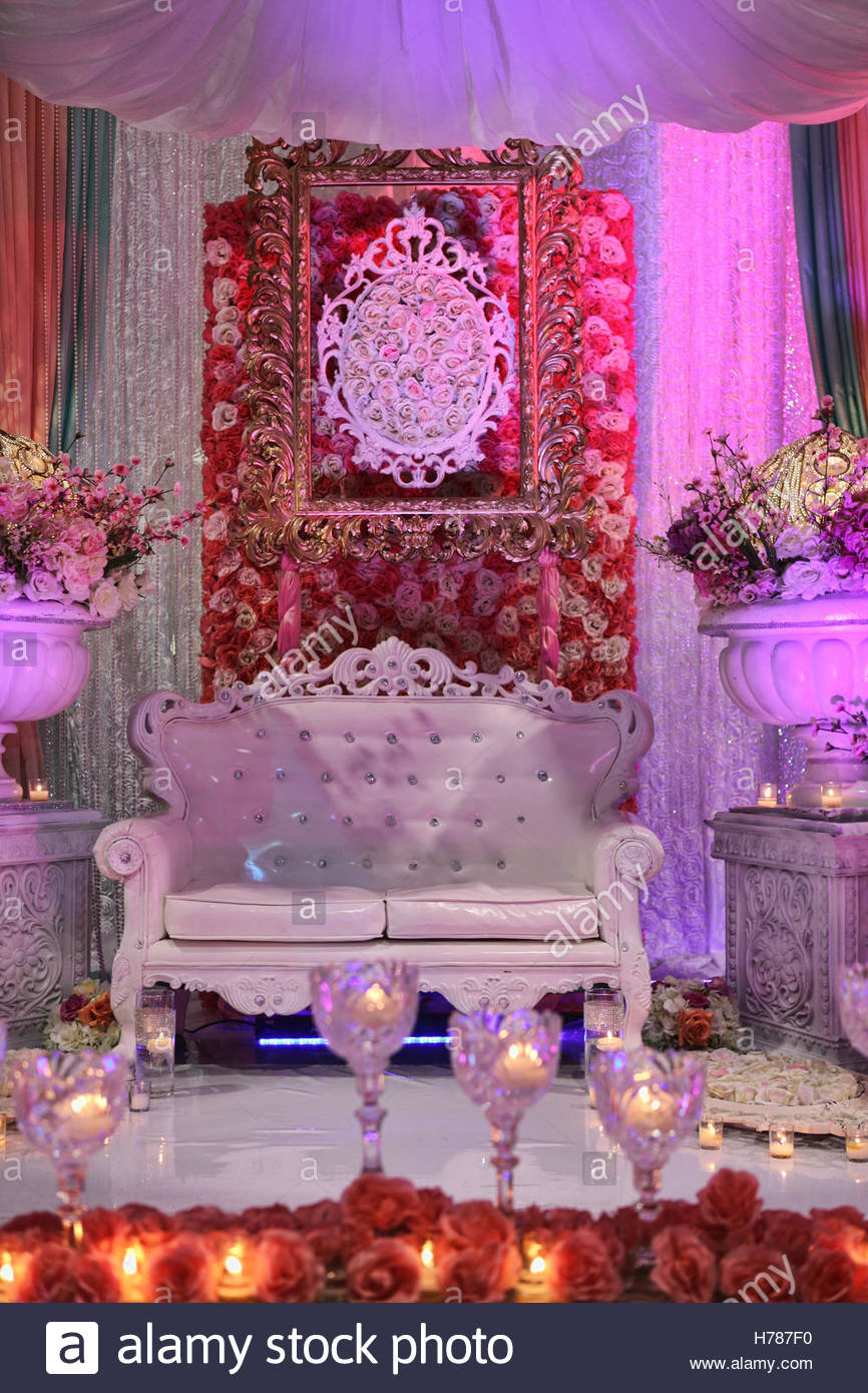 Elaborate South Asian themed wedding decor at a marriage hall in Ontario, Canada. - Stock Image