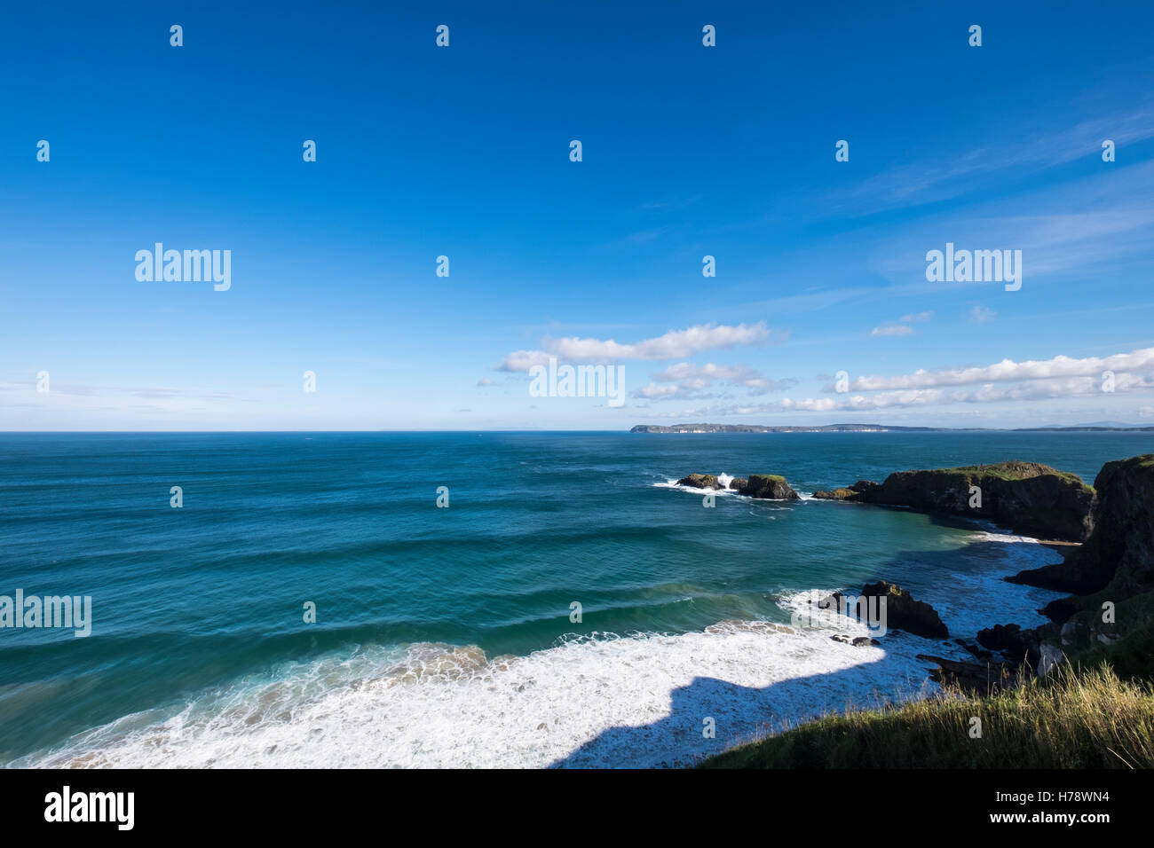 North Antrim coastline looking towards Scotland at Carric a Rede, Ireland - Stock Image