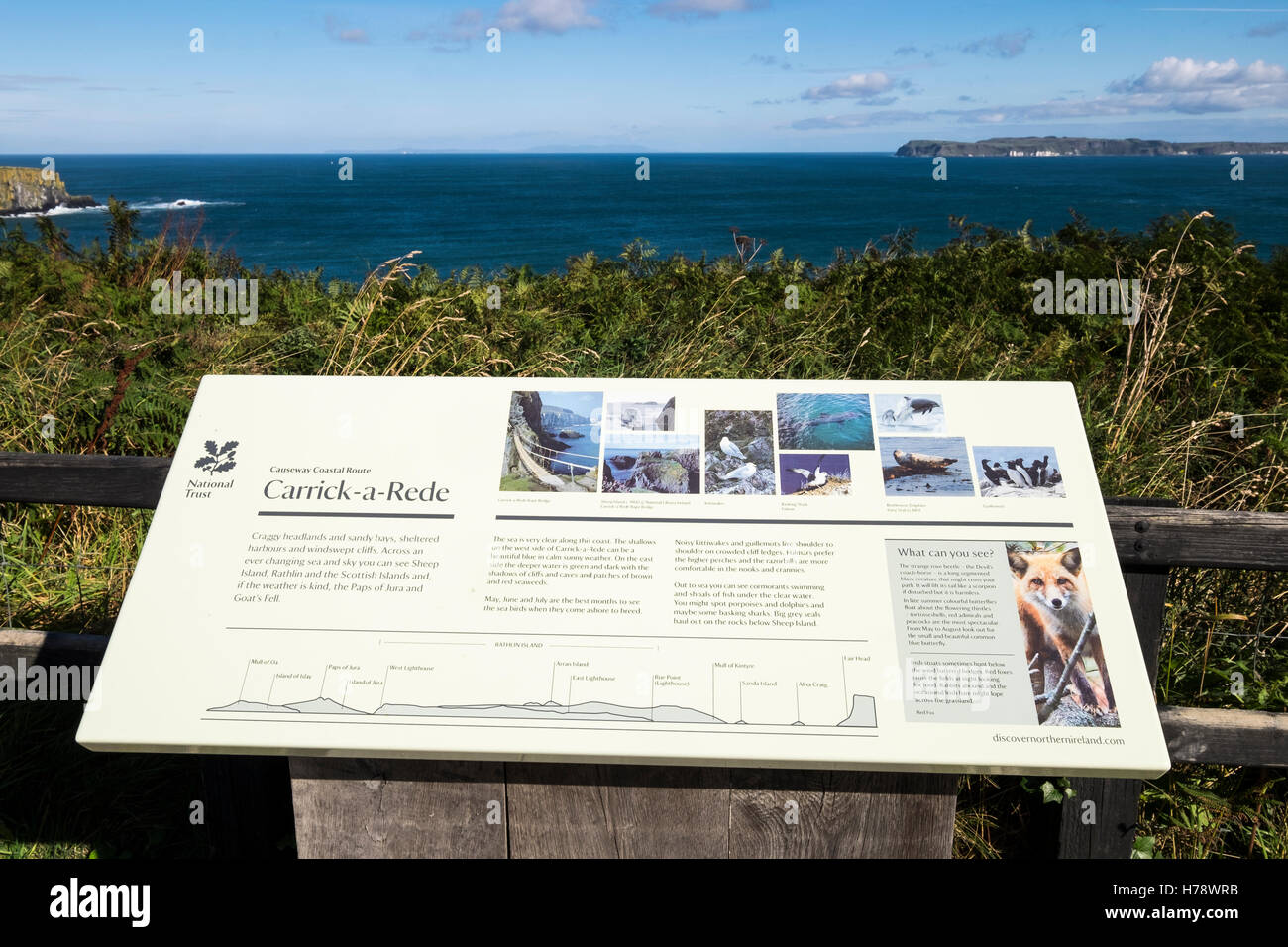 Touristic information board at Carrick a Rede on the north Antrim coastline, Ireland - Stock Image