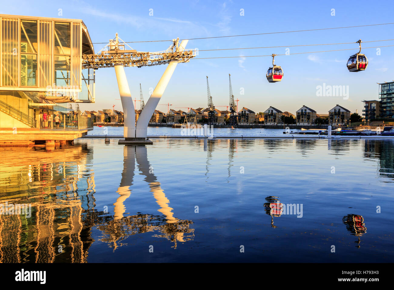 The Emirate Air Line or Thames cable car in London at sunset - Stock Image