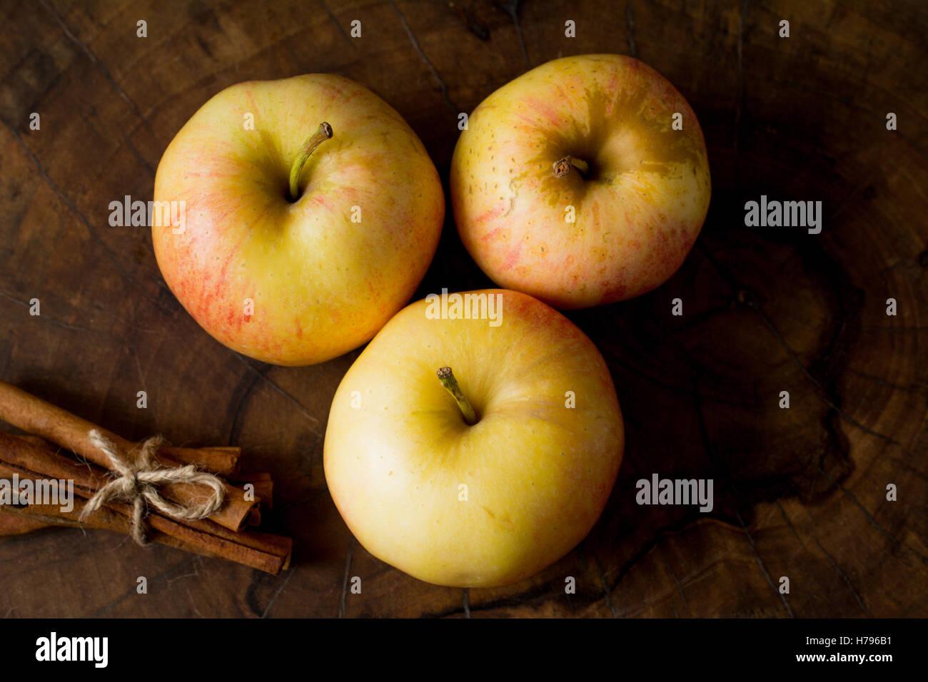Apples and cinnamon sticks, food still life Stock Photo