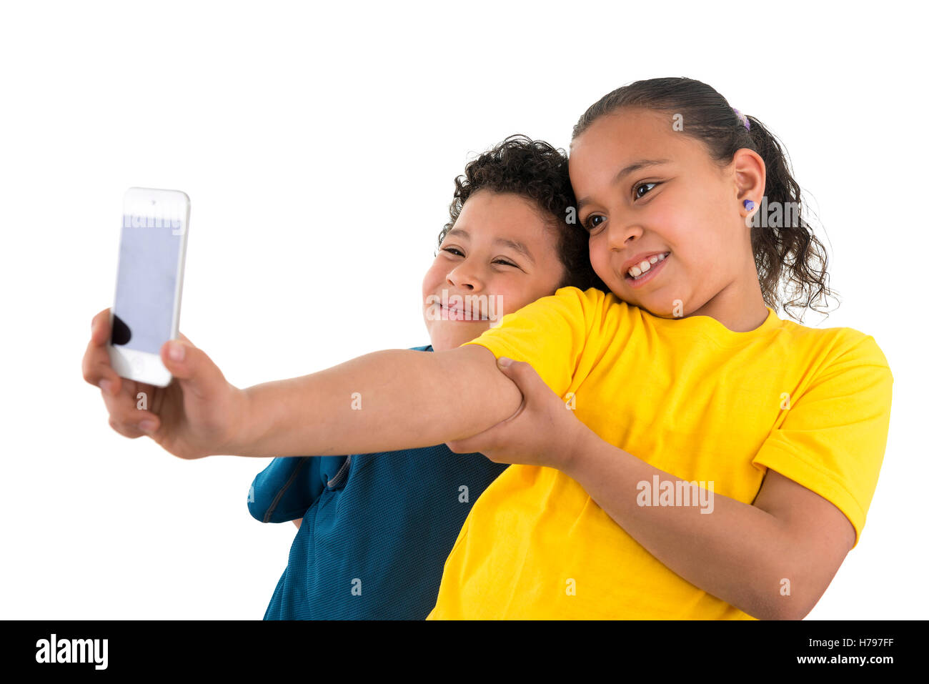 Young Boy and Girl Taking a Selfie Isolated on White Background - Stock Image