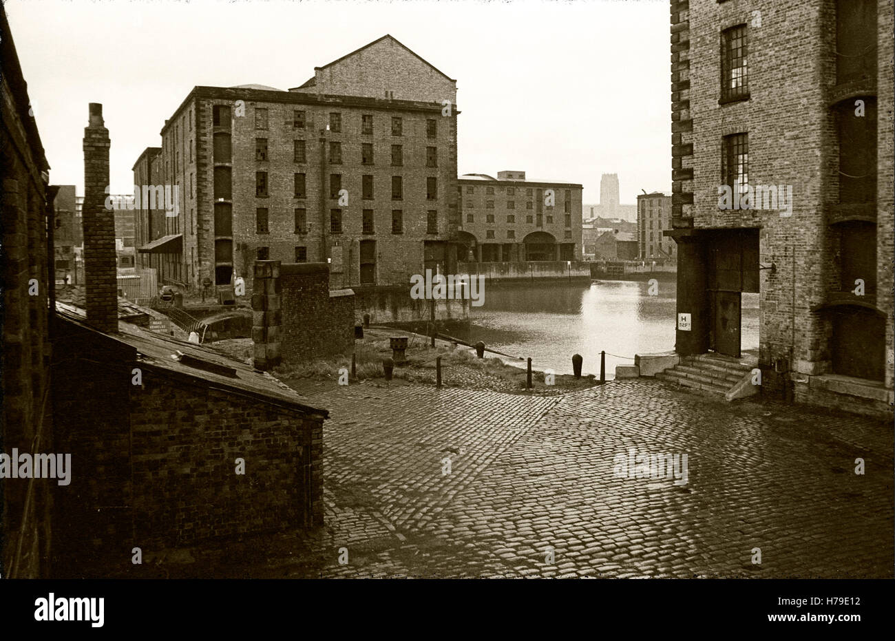 The Albert Dock, designed by Jesse Hartley,  was opened in 1846, was the first structure in Britain to be built - Stock Image