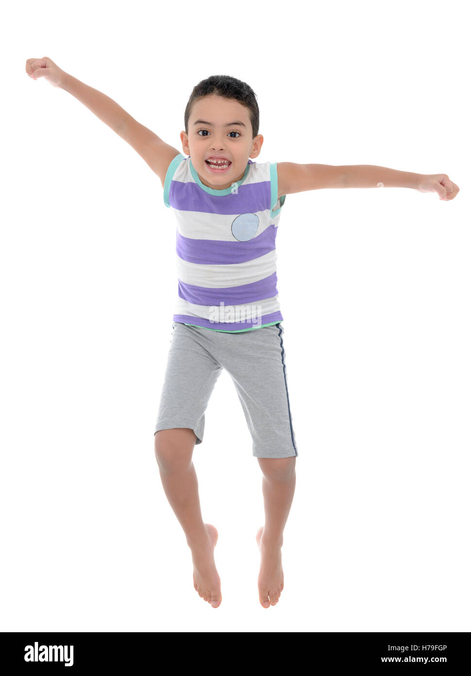 Active Joyful Boy Jumping With Joy Isolated on White Background - Stock Image