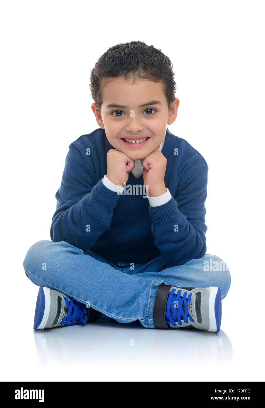 Cute Happy Boy Sitting Isolated on White Background - Stock Image
