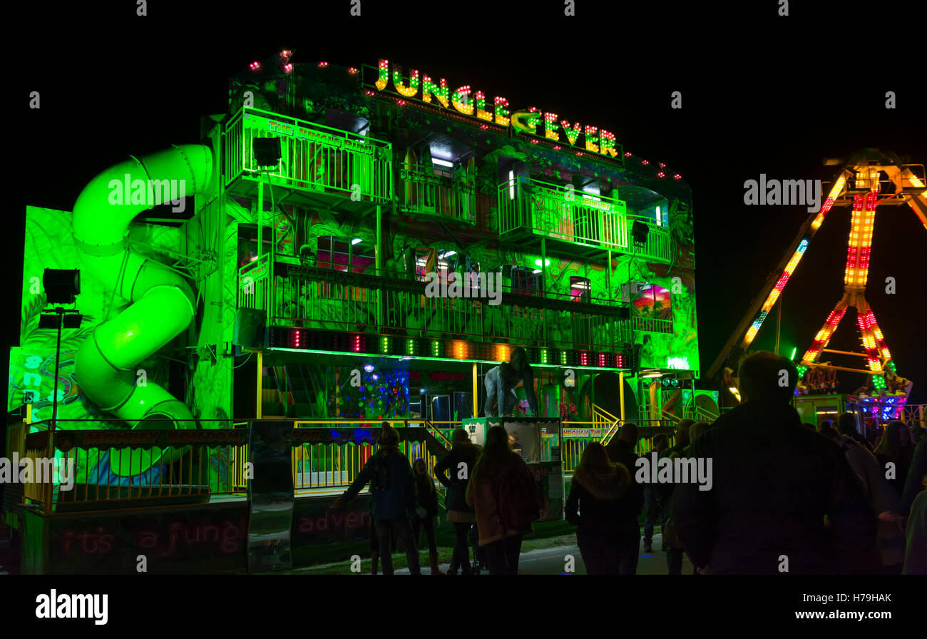 Jungle Fever fairground ride at night at an outdoor event. - Stock Image
