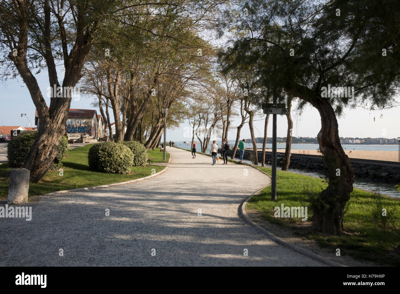 Socoa, people walking on new pathway in port area Stock Photo