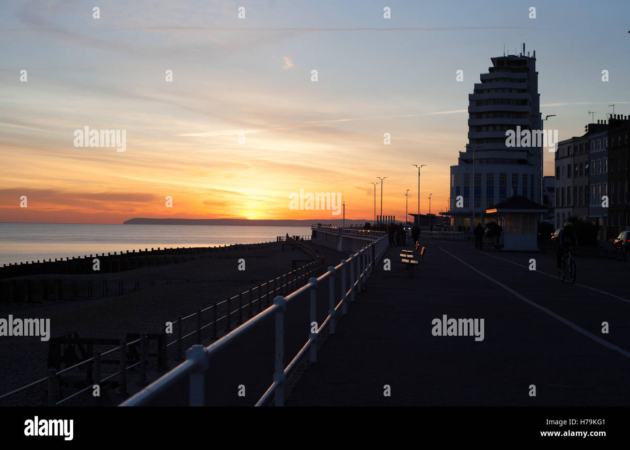 Sunset over the sea and Marine Court built in 1938, St Leonards-on-Sea  East Sussex, UK - Stock Image