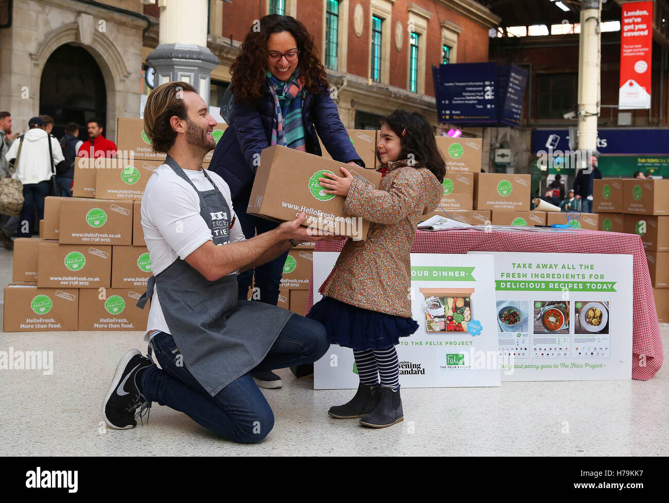 Editorial use only chef patrick drake gives rima yared and her stock editorial use only chef patrick drake gives rima yared and her daughter maya5 a recipe box from food delivery service hellofresh to raise money for food forumfinder Gallery