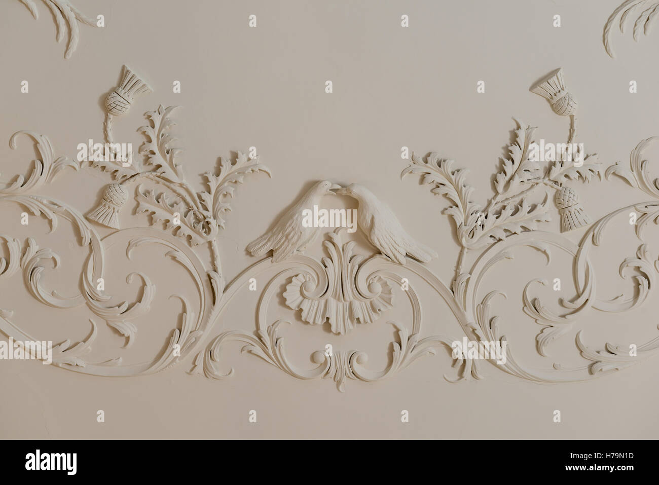Platerwork detail of birs and thistles in 18th century Dumfries house, Ayrshire, Scotland - Stock Image