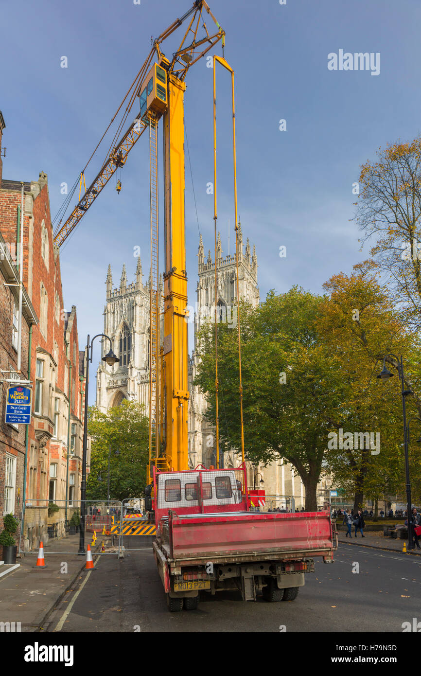 A huge crane in front of York Minster during nearby construction work - Stock Image