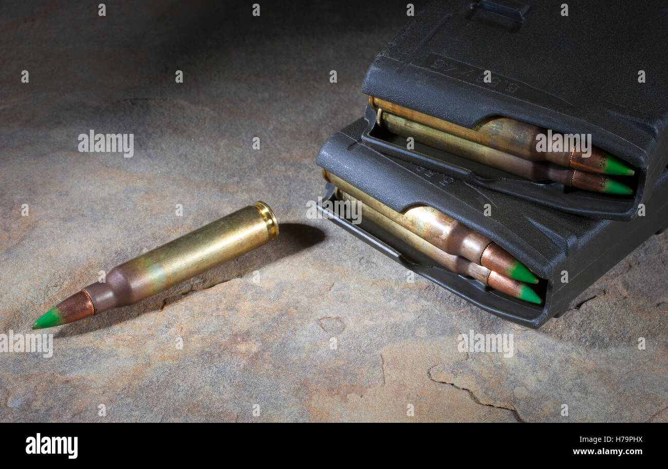 Armor piercing cartridges with green tipped bullets and magazine - Stock Image