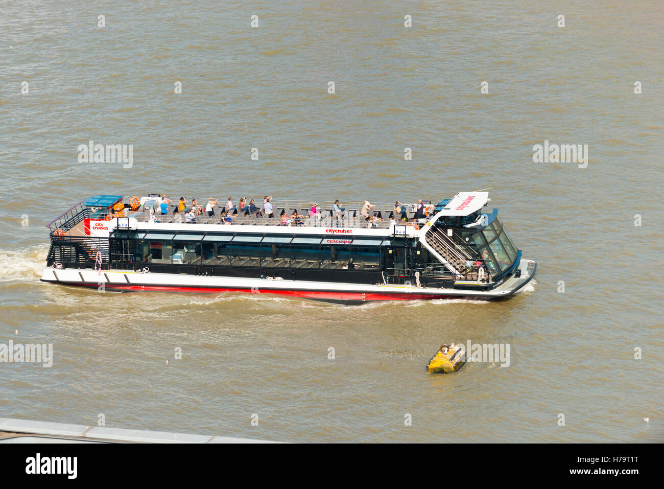 London Southbank Tate Modern Alpha City Cruise boat ship on River Thames with tourists - Stock Image