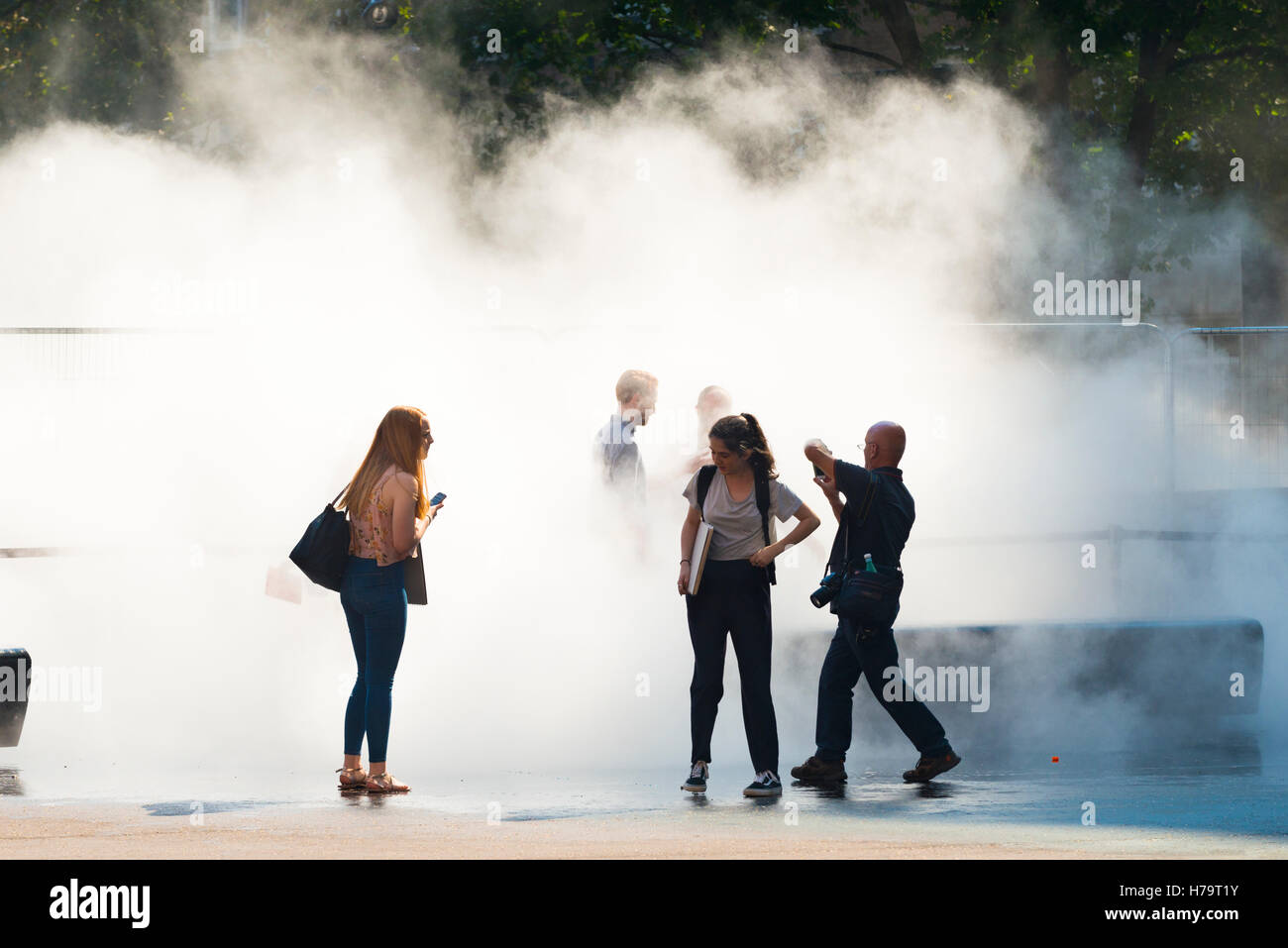 London Southbank Tate Modern water mist work of art feature group of people take photo photos in mist - Stock Image
