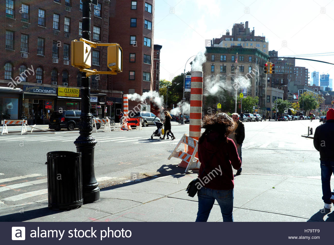 Street scene on 7th Avenue South (Greenwich Village), showing the steam funnel vents. Manhattan, New York, USA. Stock Photo