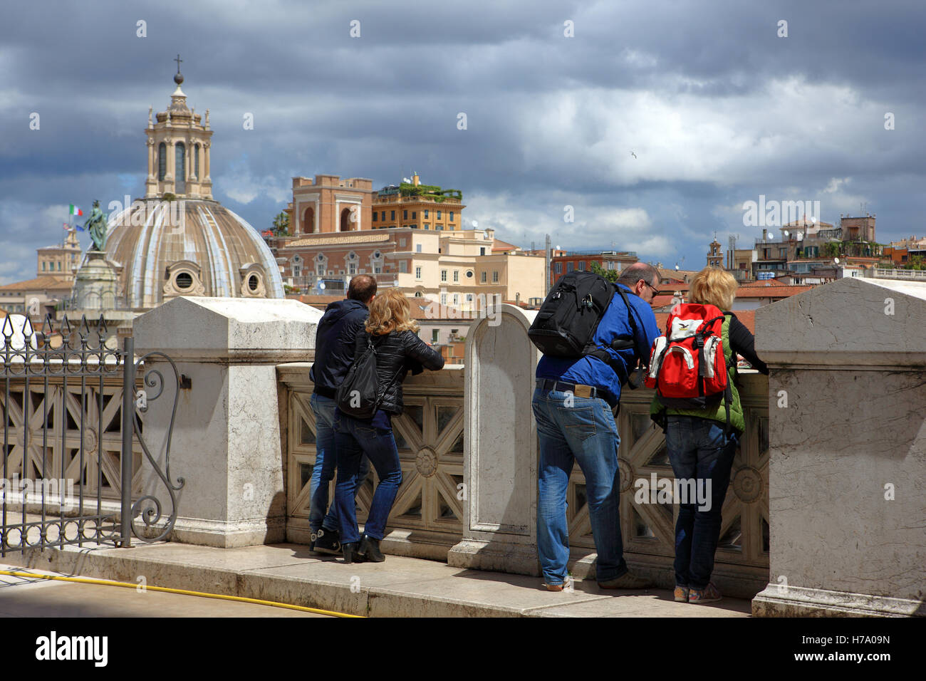 Tourists in Rome take in the view from the Terrace of the Chariots ...