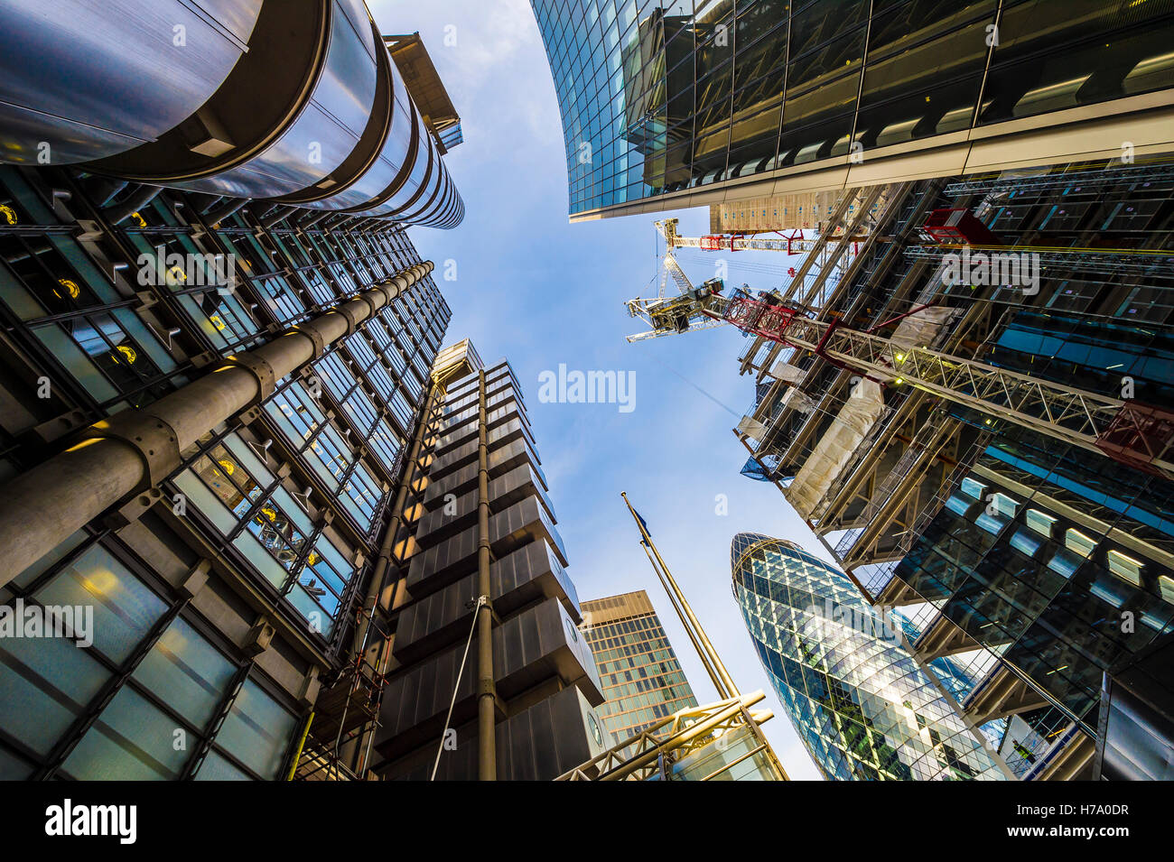 LONDON - NOVEMBER 3, 2016: The Lloyds Building and The Gherkin skyscrapers are joined by construction in the insurance - Stock Image