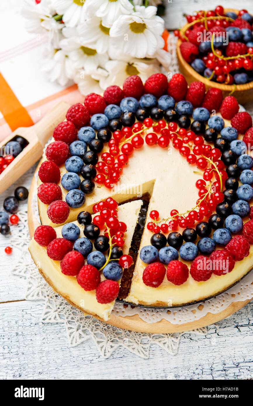 Raspberry and blueberry cheesecake on wooden table Stock Photo