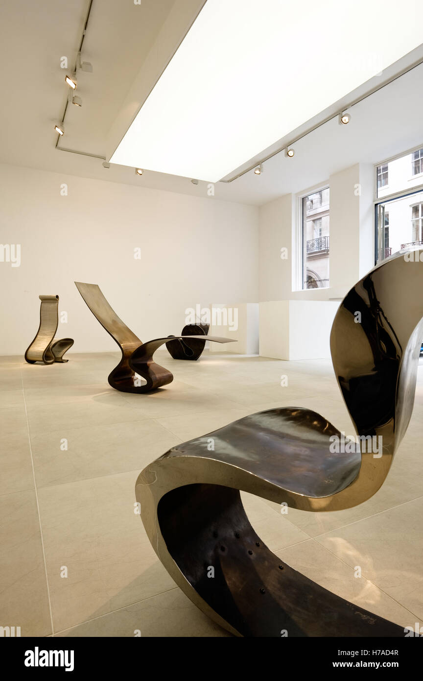 Metal seating in Carpenters Workshop Gallery exhibition space in London - Stock Image