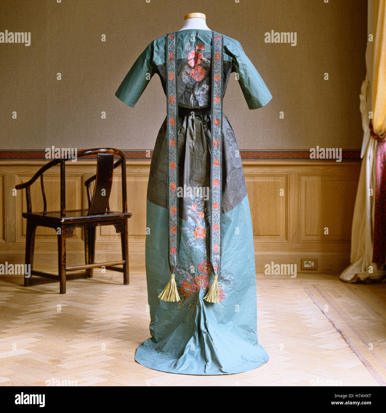 Blue and grey evening dress with floral design on historical replica paper dress by Isabelle de Borchgrave - Stock Image