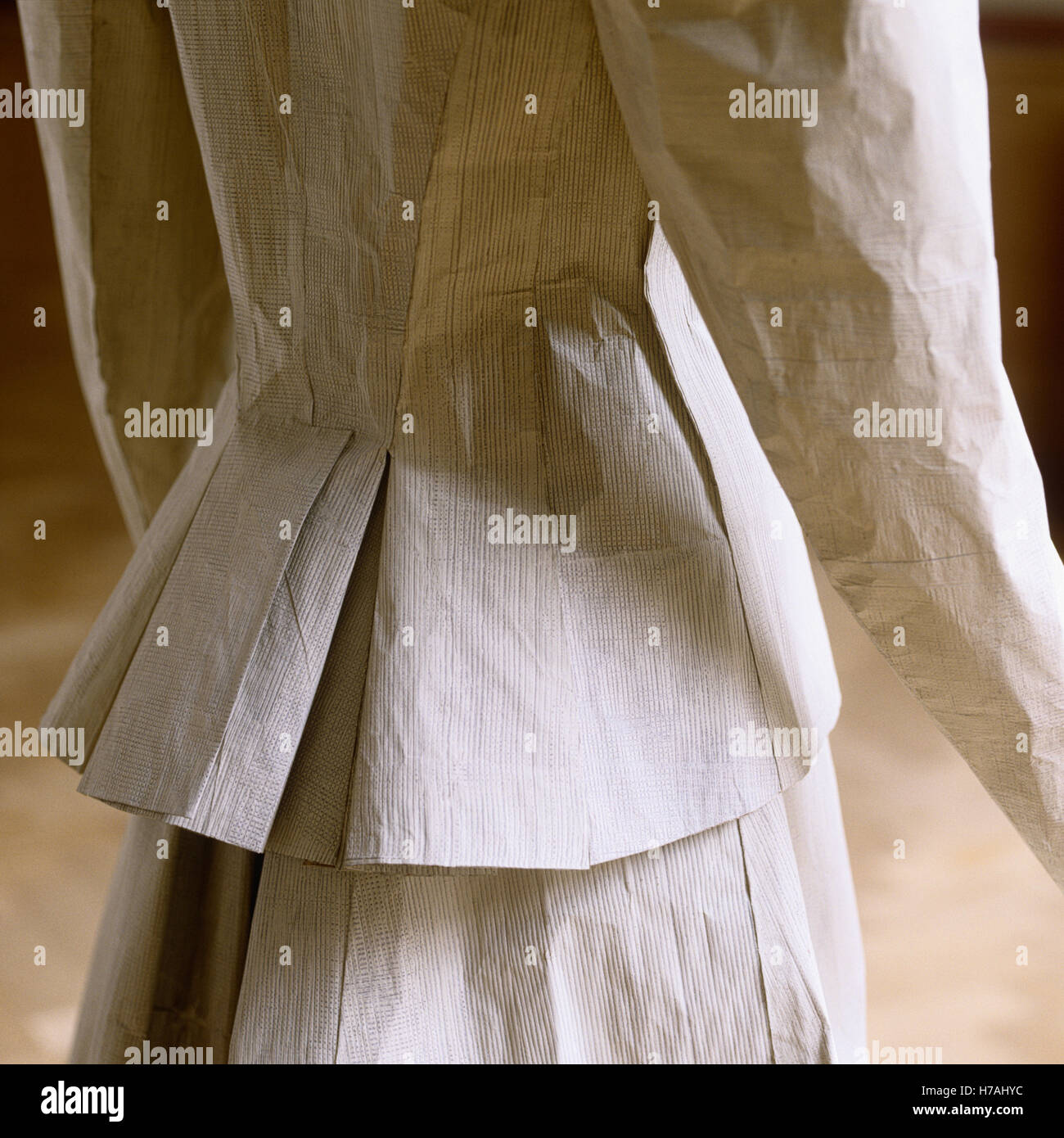 Pleated jacket detail, historical replica paper dress by Isabelle de Borchgrave - Stock Image